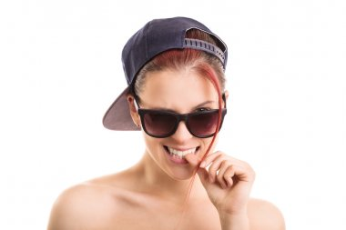 Young girl wearing sunglasses and a snapback cap