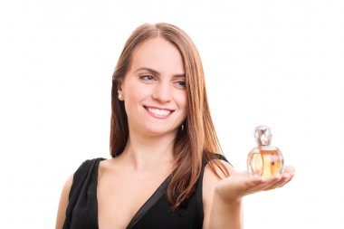 Young woman holding a perfume bottle