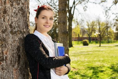 Student portrait in a park