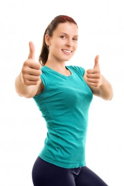 Female athlete making thumbs up