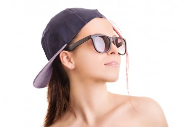 Portrait of a girl wearing hat and sunglasses
