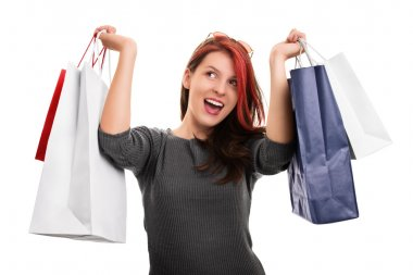 Young girl with shopping bags isolated on white background