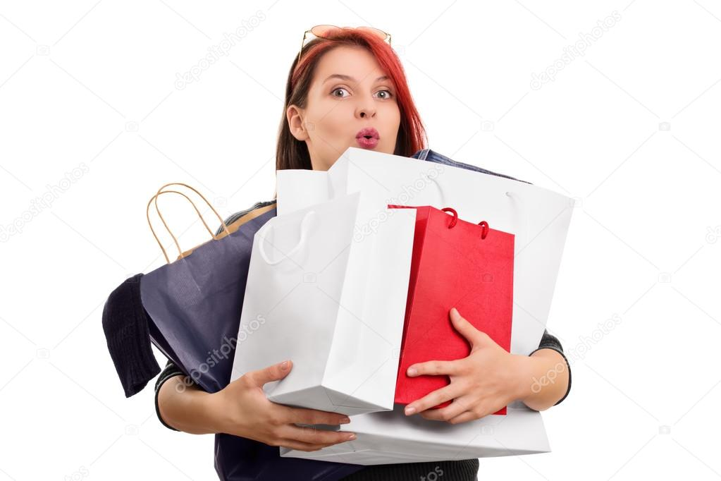 Excited young girl with shopping bags