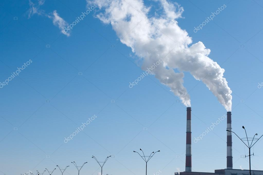 Two smoking chimneys pollution air