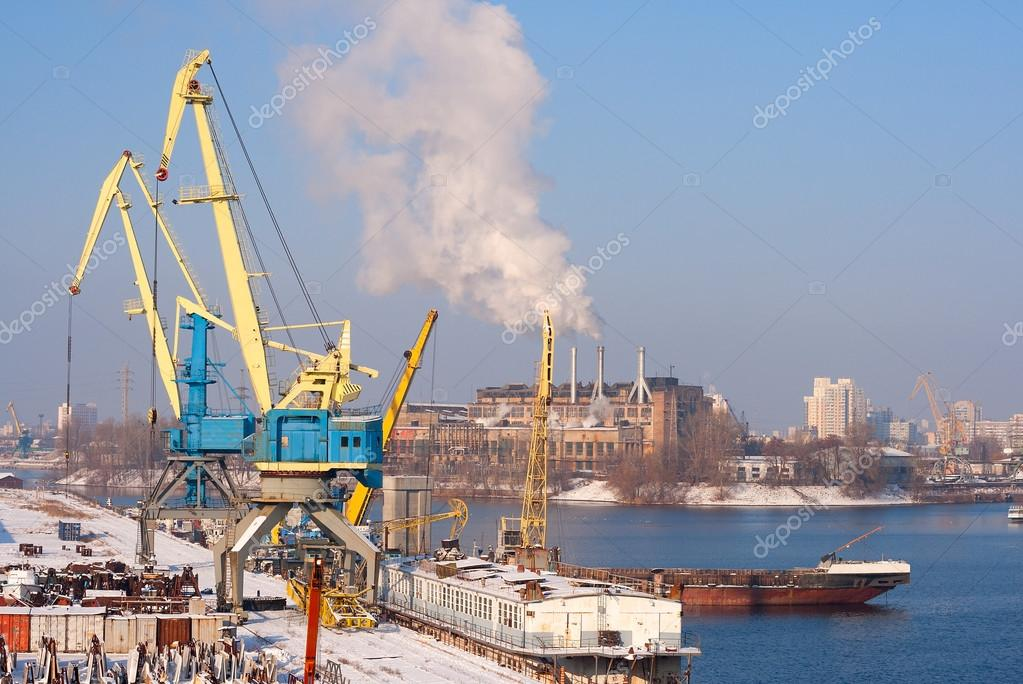 view to empty cargo dock with cranes and containers