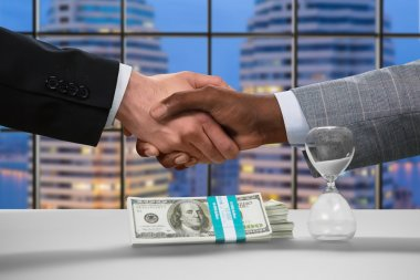 Handshake in business center