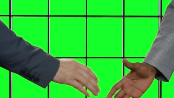 Officials shake hands.