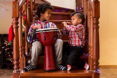 Kids play music on Christmas.