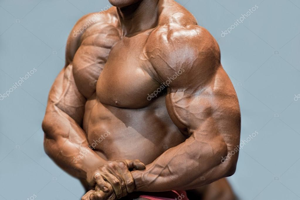 Muscular mans side chest pose.