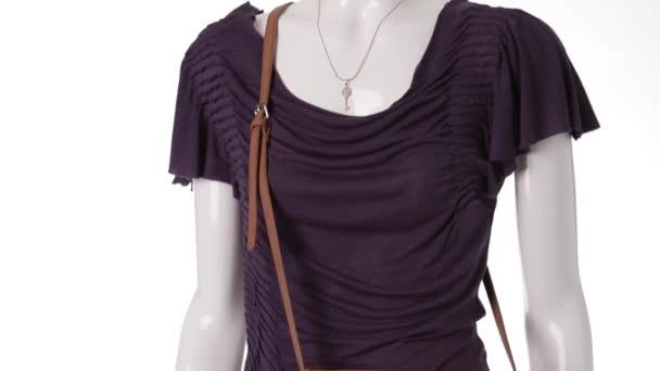 Dark purple dress on mannequin.