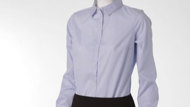 Striped blue shirt on mannequin.