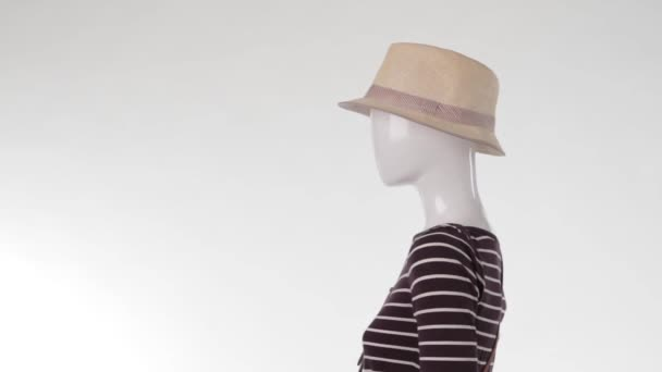 Mannequin in striped top turning.