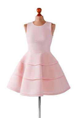 Short salmon dress with folds. Female mannequin in salmon dress. Girls custom made prom dress. Last summer dress in stock. stock vector