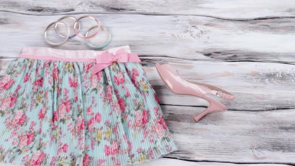 Floral skirt and salmon heels.