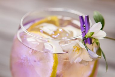 Cocktail decorated with white flower.