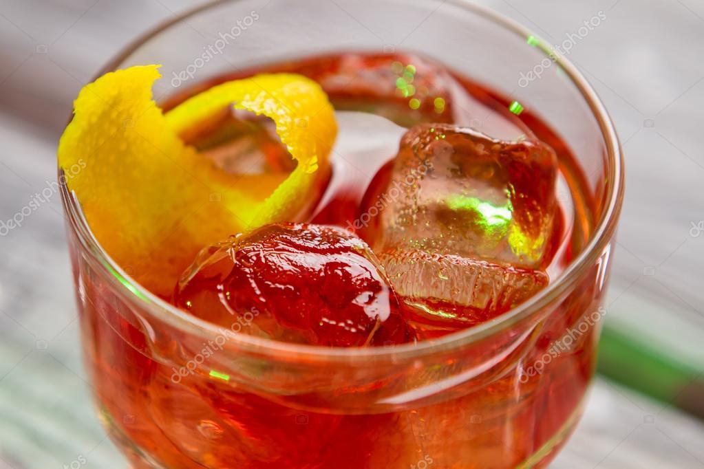 Dark orange cocktail in glass.