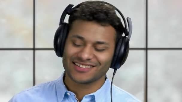 Close up happy stylish man listening to music.