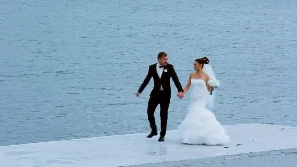 Astounding Bride And Groom Running Along The Waterfront Download Free Architecture Designs Scobabritishbridgeorg