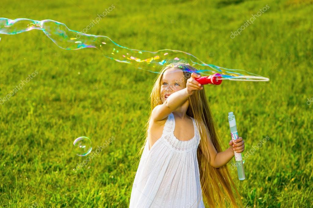 Girl blow bubbles.