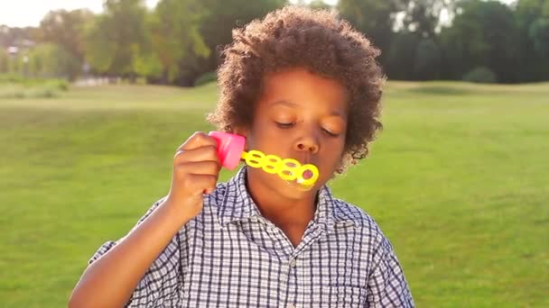 Fun boy is making bubbles.