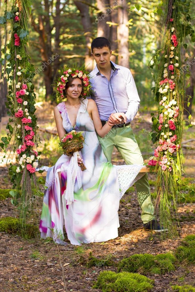 Beautiful couple on flower swing.