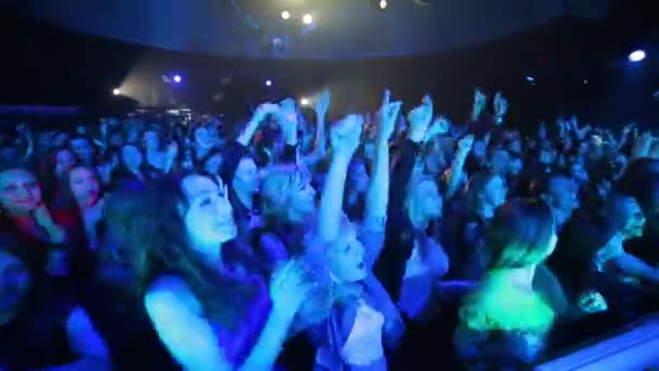 Young people at a concert.
