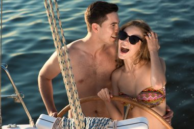 In love couple relaxing on a yacht.