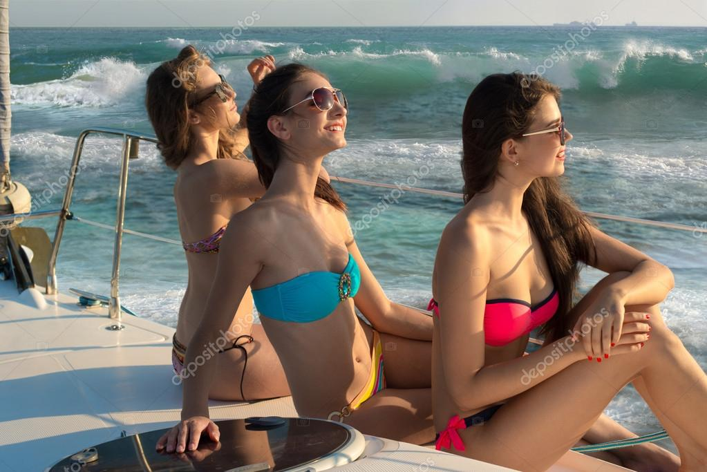 Girls sunbathing on a yacht.