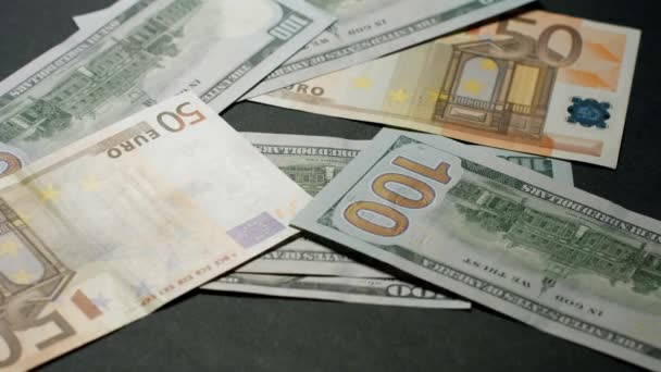 Dollars and euros are falling on the table.