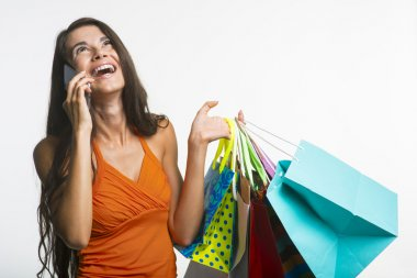 Merry lady on shopping during seasonal discounts.