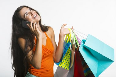 Happy lady on shopping during seasonal discounts.