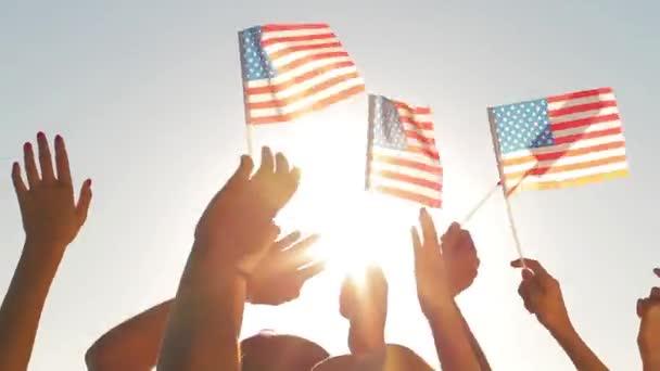 Patriots waving flags of America.