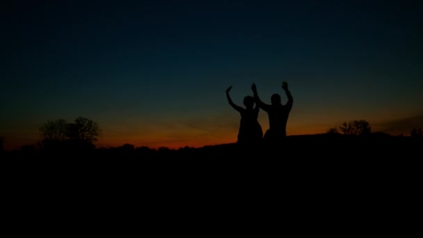 Lovers admire the beautiful sky and waving their hands.