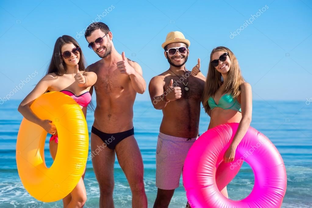 Young people having fun on the beach.