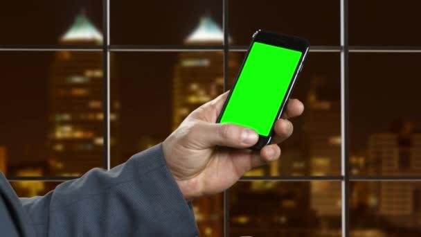 Man flips through photo in a smartphone.