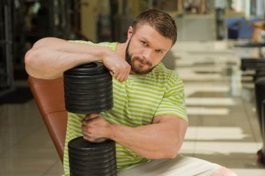 Sportsman heawyweight in gym.