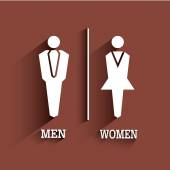 Fotografie WC znamení. Toaletní symbol. Samci a samice s dlouhý stín