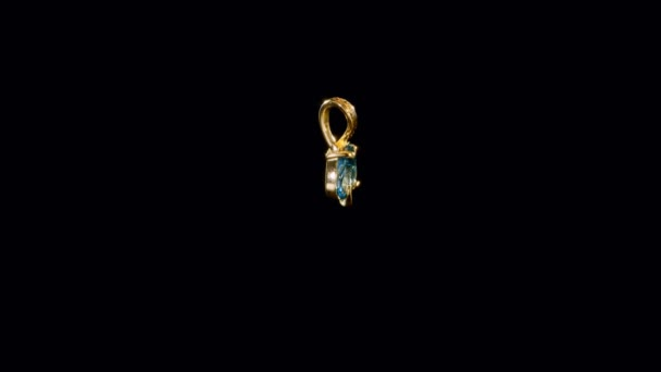 yellow gold pendant with one big blue precious sparkling  stone in  the middle and a curling row of small diamonds