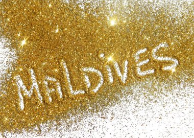 Inscription Maldives on golden glitter sparkle on white background