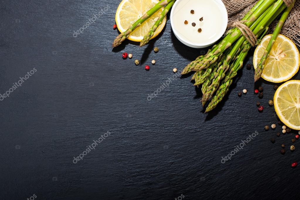 Asparagus on a dark surface. Food background
