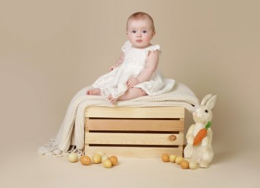 Baby with Easter Bunny and Eggs