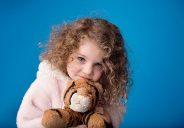 Happy Smiling Laughing Child: Girl with Curly Hair