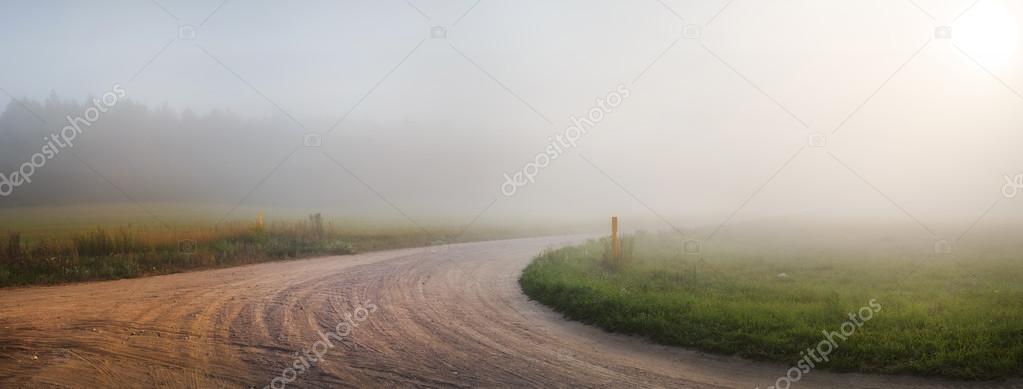 Gravel road in the fog