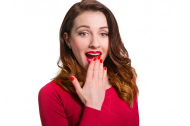 Pretty woman in red looking away in awe surprised with mouth ope