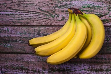 Bananas on the purple background