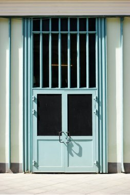 Entrance with black windows