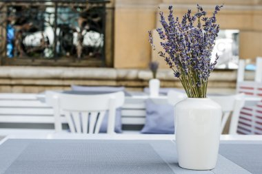 Lavender bouquet at the table in the street cafe