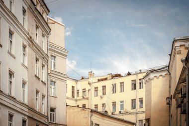 Roofs of the houses in Moscow courtyard under the blue sky