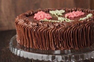 Kiev cake with chocolate cream on the glass stand horizontal
