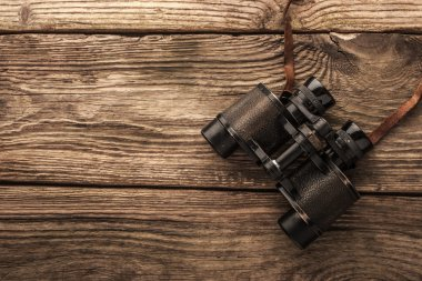 Binoculars on the wooden table